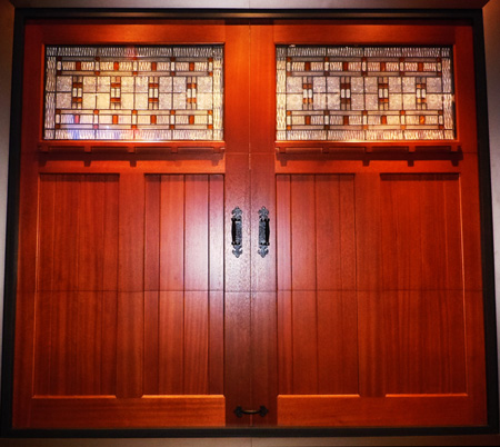 Clopay Custom Reserve Collection garage door with Cimarron glass in Meranti wood factory-stained with a Butternut finish. & Clopay | Fiberglass Entry Doors