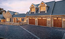 Canyon Ridge Collection Limited Edition Series Garage Doors with Stone Home
