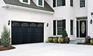 Black Gallery Steel Garage Doors with White Home